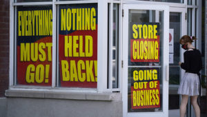 FILE - In this Aug. 30, 2020, file photo, store closing signs are shown on a Stein Mart store in Salt Lake City. The government issues the jobs report Friday, Sept. 4, for August at a time of continuing layoffs and high unemployment. (AP Photo/Rick Bowmer, File)