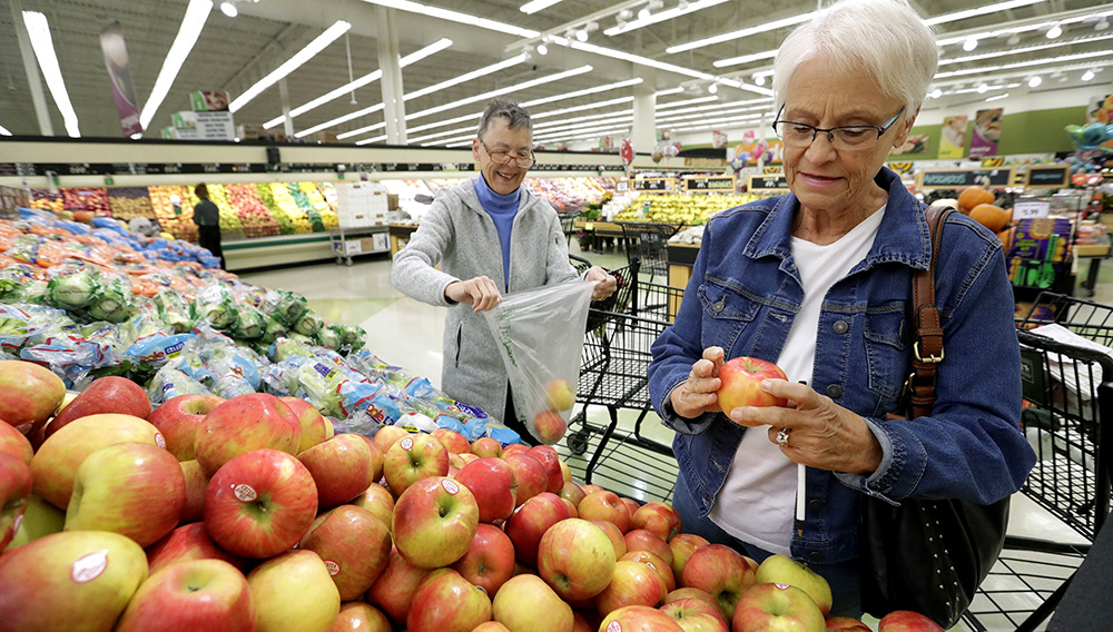 Kathy Collins, left, of Appleton and Donna Christie of Sherwood shop for produce at Festival Foods on Van Roy Road in Appleton. | Dan Powers/USA TODAY NETWORK-Wisconsin
