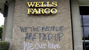 Graffiti covers the exterior of a Wells Fargo bank on Wednesday, July 1, 2020, in a historically Black neighborhood in Portland, Ore., that has been the scene of violent clashes with police in recent days. (AP Photo/Gillian Flaccus)