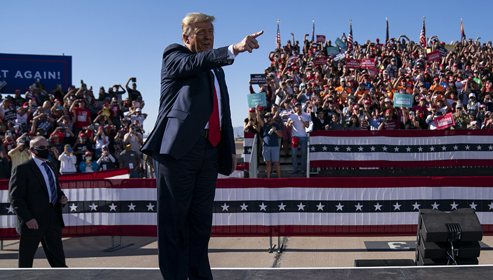 President Donald Trump gestures to supporters as he arrives for a campaign rally at Phoenix Goodyear Airport, Wednesday, Oct. 28, 2020, in Goodyear, Ariz. (AP Photo/Evan Vucci)
