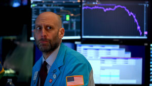 A trader works during the closing bell at the New York Stock Exchange at Wall Street, New York City, Tuesday, March 17, 2020. (AFP Photo)