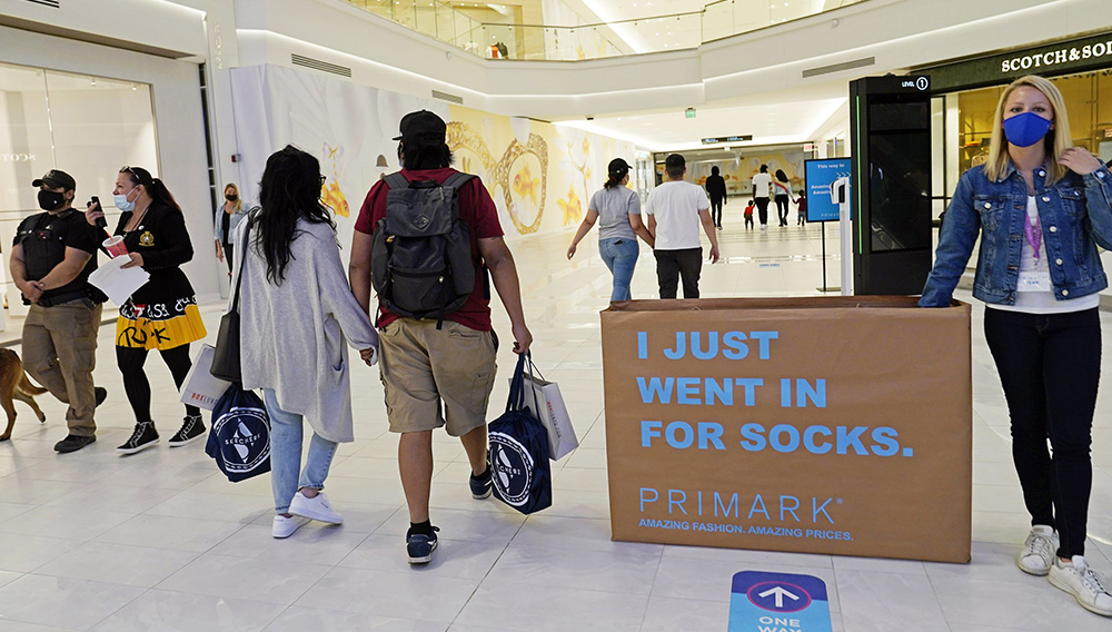 FILE - In this Thursday, Oct. 1, 2020, file photo, shoppers and pedestrians walk through a concourse at the American Dream Mall in East Rutherford, N.J. U.S. consumer confidence dipped slightly in October as a new wave of coronavirus cases began across the country. (AP Photo/Kathy Willens, File)