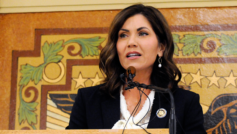 FILE – In this Jan. 8, 2019 file photo, South Dakota Gov. Kristi Noem gives her first State of the State address in Pierre, S.D. While many other governor's have broken from President Donald Trump on stay-at-home orders to curb the spread of coronavirus or when to restart economic activity, Noem has tracked close to the president. (AP Photo/James Nord, File)