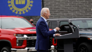 FILE PHOTO: Speaking in front of a backdrop of American-made vehicles and a United Auto Workers (UAW) sign, Democratic U.S. presidential nominee and former Vice President Joe Biden speaks about new proposals to protect U.S. jobs during a campaign stop in Warren, Michigan, U.S., September 9, 2020. REUTERS/Leah Millis/File Photo