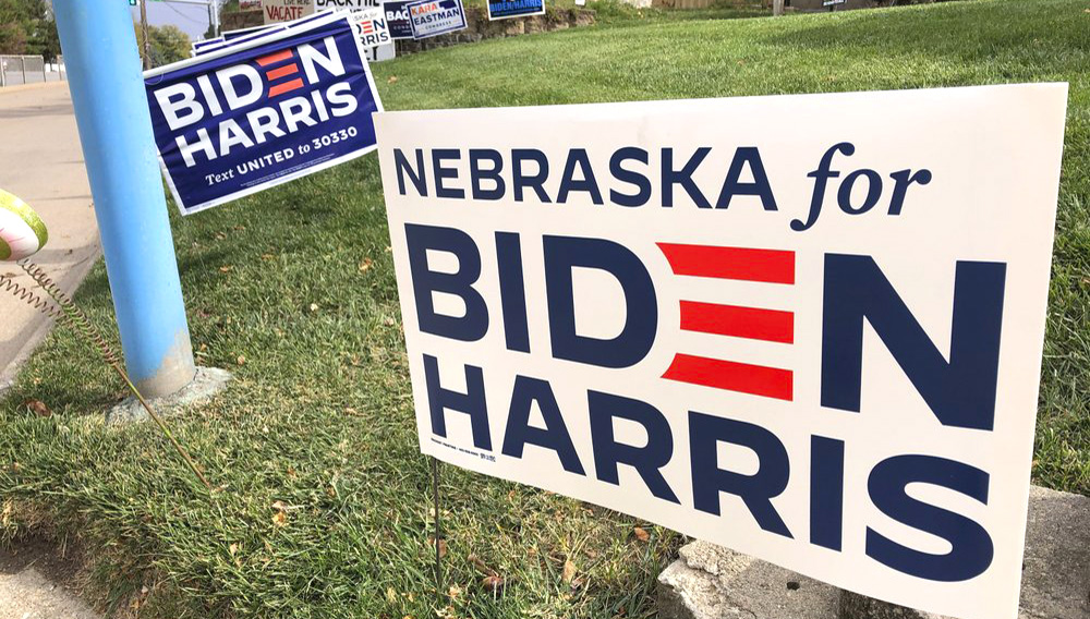 A Joe Biden presidential campaign sign greets passersby in a leafy neighborhood of Omaha, Neb., Monday, Oct. 19, 2020. (AP Photo/Grant Schulte)