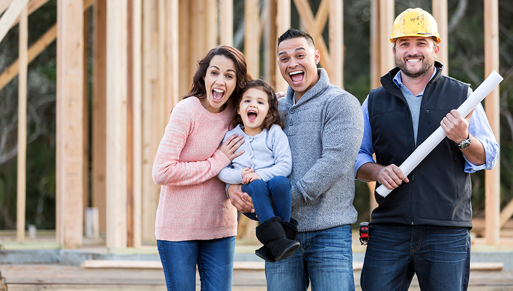 An Hispanic family with a cute little 3 year old daughter, at the construction site where their new home is being built.   Photo: kali9/Getty Images