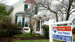 This Wednesday, April 12, 2017, photo shows a home for sale, in Natick, Mass. (AP Photo/Steven Senne)