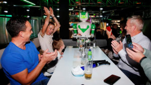FILE PHOTO: A robot delivers a birthday cake at Robotazia restaurant as the coronavirus disease (COVID-19) outbreak continues in Milton Keynes, Britain, October 2, 2020. REUTERS/Andrew Boyers/File Photo