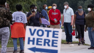 People wait in line to vote in Decatur, Ga., Monday, Oct. 12, 2020. (Ben Gray/Atlanta Journal-Constitution via AP)