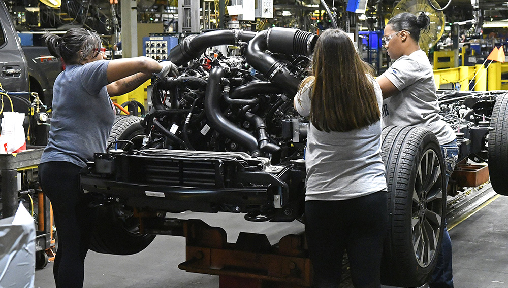 In this Friday, Oct. 27, 2017, photo, workers assemble Ford trucks at the Ford Kentucky Truck Plant, in Louisville, Ky. (AP Photo/Timothy D. Easley)