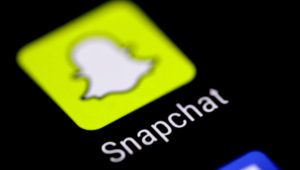 FILE PHOTO: The Snapchat messaging application is seen on a phone screen August 3, 2017. REUTERS/Thomas White