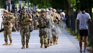 US military troops disembark from tour buses as they deploy inside the security perimeter at the White House as the George Floyd and police brutality protests continue in Washington on June 4. | Getty Images