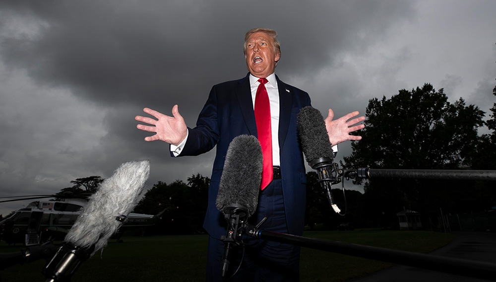 President Donald Trump speaks with reporters before walking to Marine One on the South Lawn of the White House, July 31, 2020, in Washington. | Photo: Associated Press