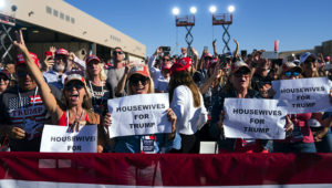 In this Oct. 28, 2020, photo, supporters of President Donald Trump listen to him speak during a campaign rally at Phoenix Goodyear Airport in Goodyear, Ariz. Trump is painting an apocalyptic portrait of American life if Democrat Joe Biden gets elected. (AP Photo/Evan Vucci)