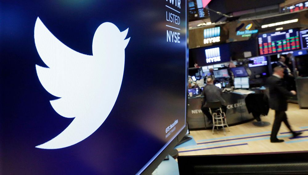 FILE - In this Feb. 8, 2018, file photo, the logo for Twitter is displayed above a trading post on the floor of the New York Stock Exchange. (AP Photo/Richard Drew, File)