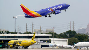 A Southwest Airlines Boeing 737-7H4 takes off, Tuesday, Oct. 20, 2020, from Fort Lauderdale-Hollywood International Airport in Fort Lauderdale, Fla. (AP Photo/Wilfredo Lee)