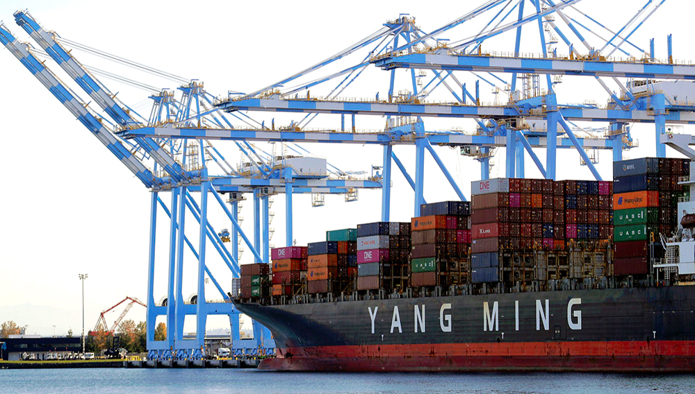 FILE - In this Nov. 4, 2019, file photo, cargo cranes are used to take containers off of a Yang Ming Marine Transport Corporation boat at the Port of Tacoma in Tacoma, Wash. The U.S. trade deficit rose in August to the highest level in 14 years. (AP Photo/Ted S. Warren, File)