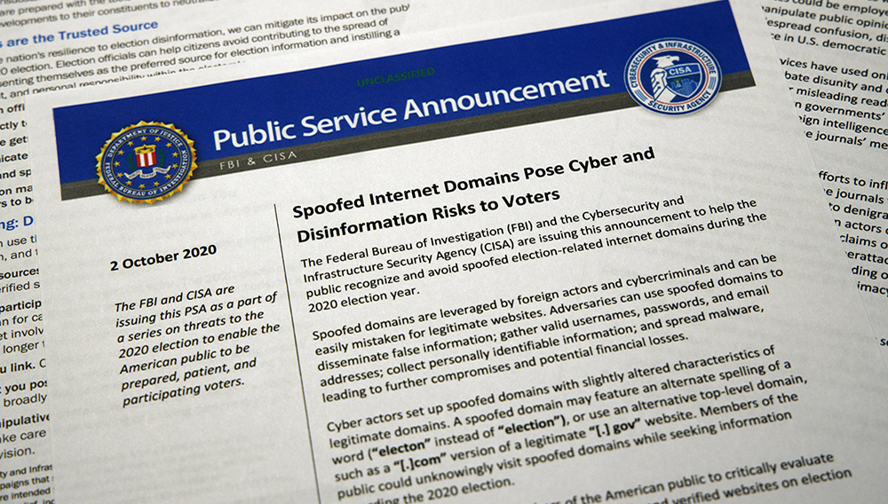 A public service announcement from the FBI and the Department of Homeland Security cybersecurity agency is photographed Tuesday, Oct. 6, 2020. (AP Photo/Jon Elswick)