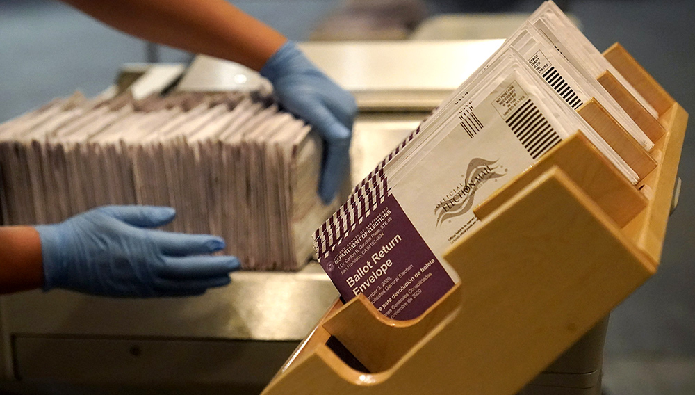 Envelopes containing ballots are shown at a San Francisco Department of Elections at a voting center in San Francisco, Sunday, Nov. 1, 2020. (AP Photo/Jeff Chiu)