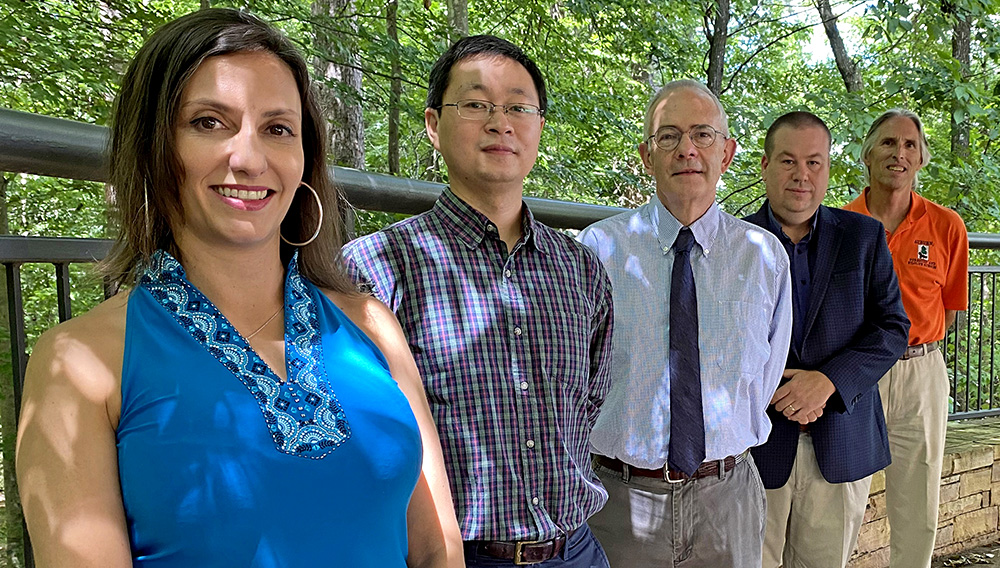 Auburn University School of Forestry and Wildlife Sciences faculty members Sole Peresin, Yucheng Peng, Graeme Lockaby, Brian Via and Tom Gallagher are exploring ways to give new life to timber decimated by hurricanes.