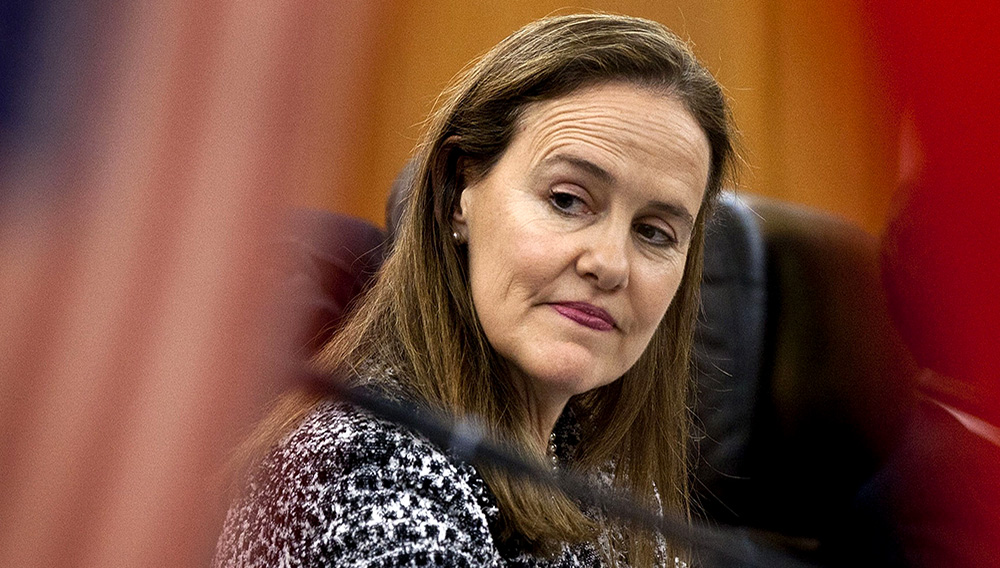 This Dec. 7, 2011 file photo shows former U.S. Defense Undersecretary Michele Flournoy, preparing for a bilateral meeting in Beijing, China. Flournoy, a politically moderate Pentagon veteran, is regarded by U.S. officials and political insiders as a top choice for President-elect Joe Bide to choose to head the Pentagon. (AP Photo/Andy Wong, File)