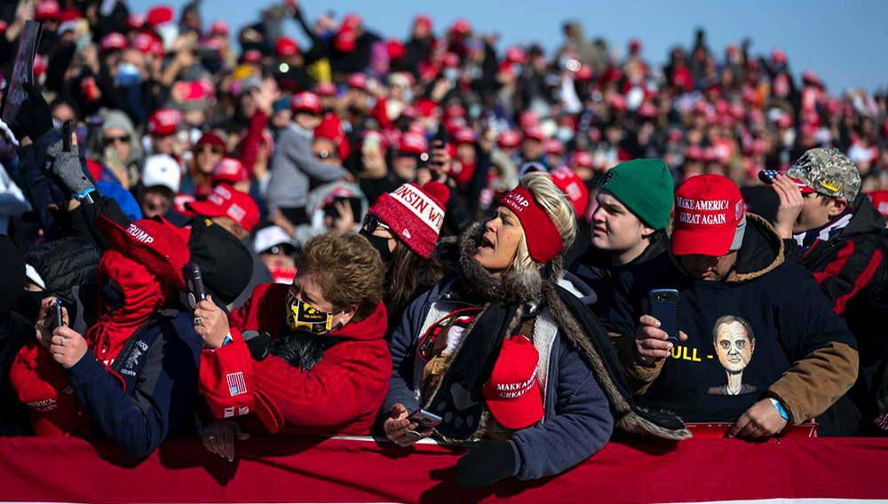 Supporters of President Donald Trump listen to him speak during a campaign rally at Dubuque Regional Airport, Sunday, Nov. 1, 2020, in Dubuque, Iowa. (AP Photo/Evan Vucci)