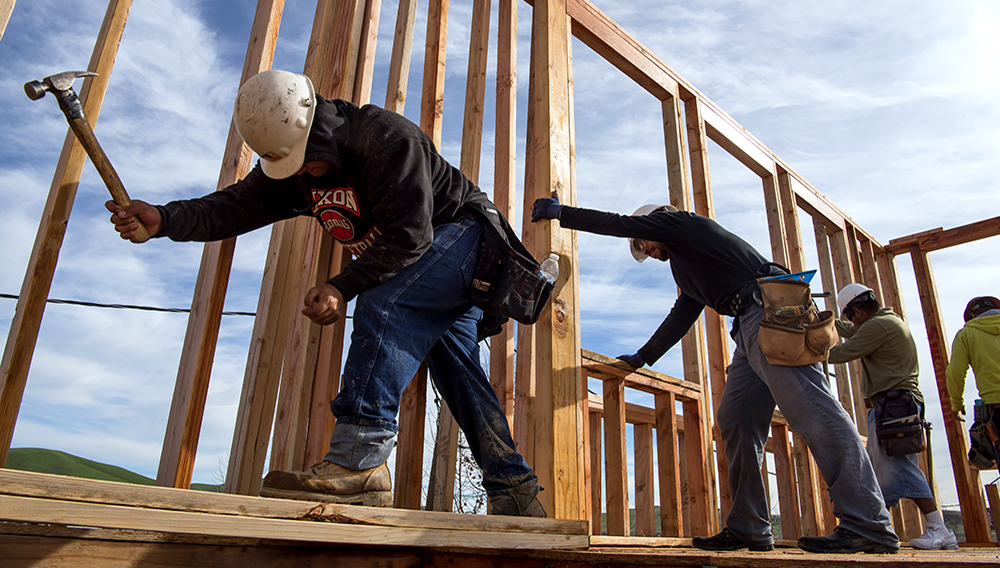 Contractors secure a wall section on a home under construction at the Toll Brothers Cantera at Gale Ranch housing development in San Ramon, California. David Paul Morris | Bloomberg | Getty Images