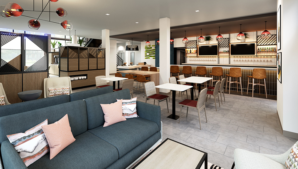 Atwell Suites' main lobby space adjacent to the check-in counter is designed to bring people together around the breakfast area, lounge and bar.