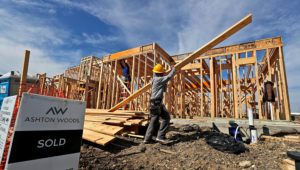 A construction crew works on an already sold new home in north Dallas. | Photo: LM Otero, AP