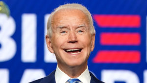 Democratic U.S. presidential nominee Joe Biden smiles as he speaks about the results of the 2020 U.S. presidential election during an appearance in Wilmington, Delaware, U.S., November 4, 2020. REUTERS/Kevin Lamarque