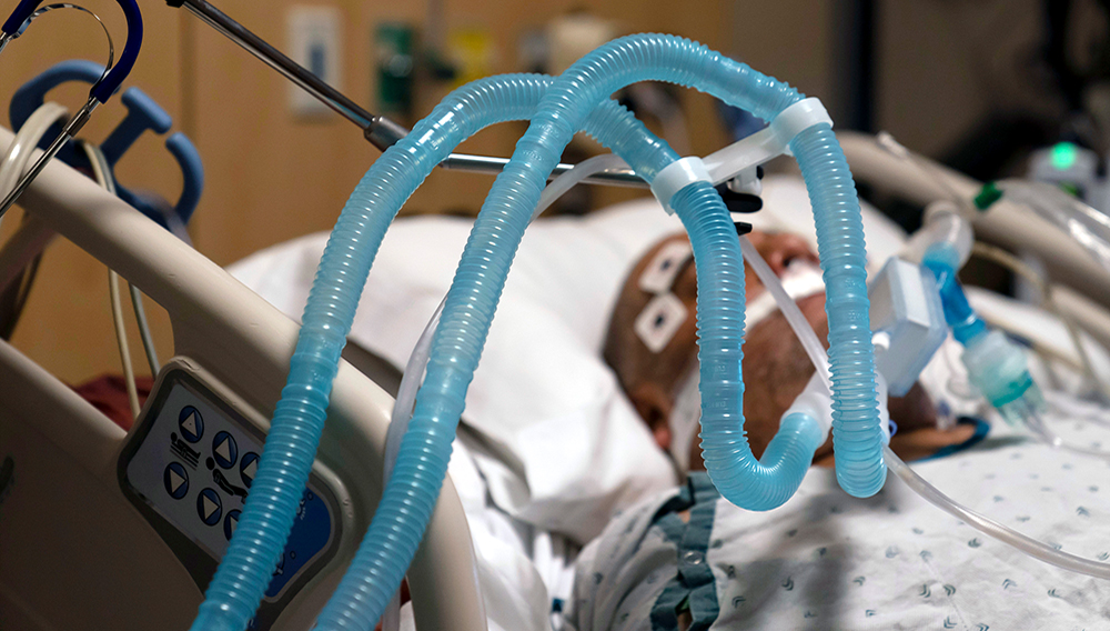 Ventilator tubes are attached a COVID-19 patient at Providence Holy Cross Medical Center in the Mission Hills section of Los Angeles, Thursday, Nov. 19, 2020. (AP Photo/Jae C. Hong)
