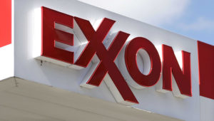 FILE- This April 25, 2017, file photo, shows an Exxon service station sign in Nashville, Tenn. Exxon Mobil reported on Friday, Oct. 30, 2020, lost $680 million in the third quarter as the global pandemic curtailed travel throughout the world, diminishing the need for fuel. (AP Photo/Mark Humphrey, File)