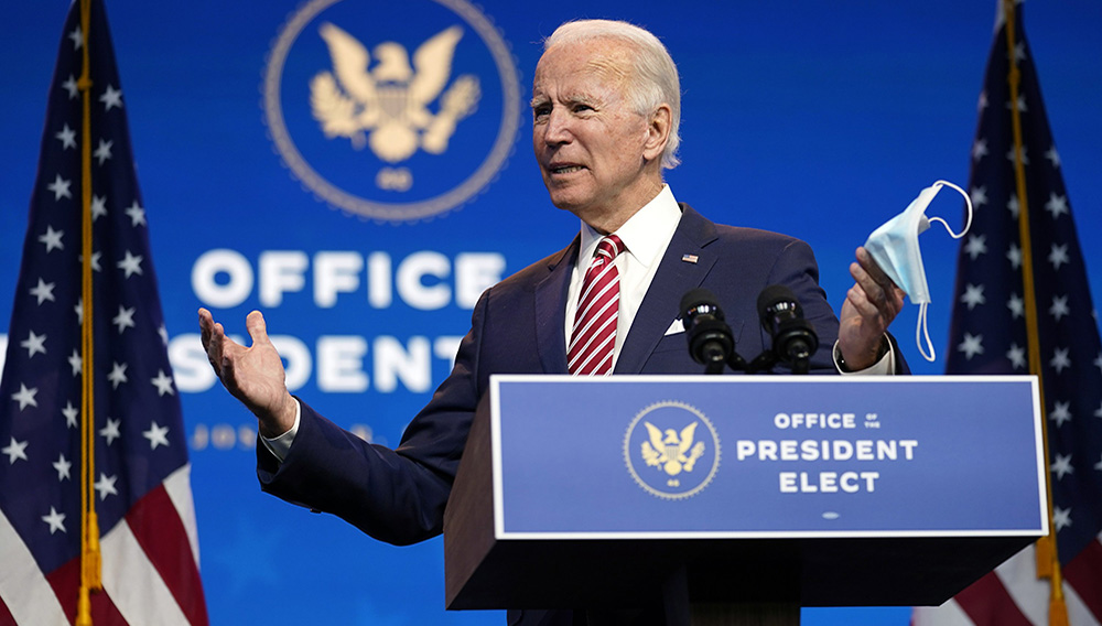 President-elect Joe Biden, accompanied by Vice President-elect Kamala Harris, speaks about economic recovery at The Queen theater, Monday, November 16, 2020, in Wilmington, Del. (AP Photo/Andrew Harnik)