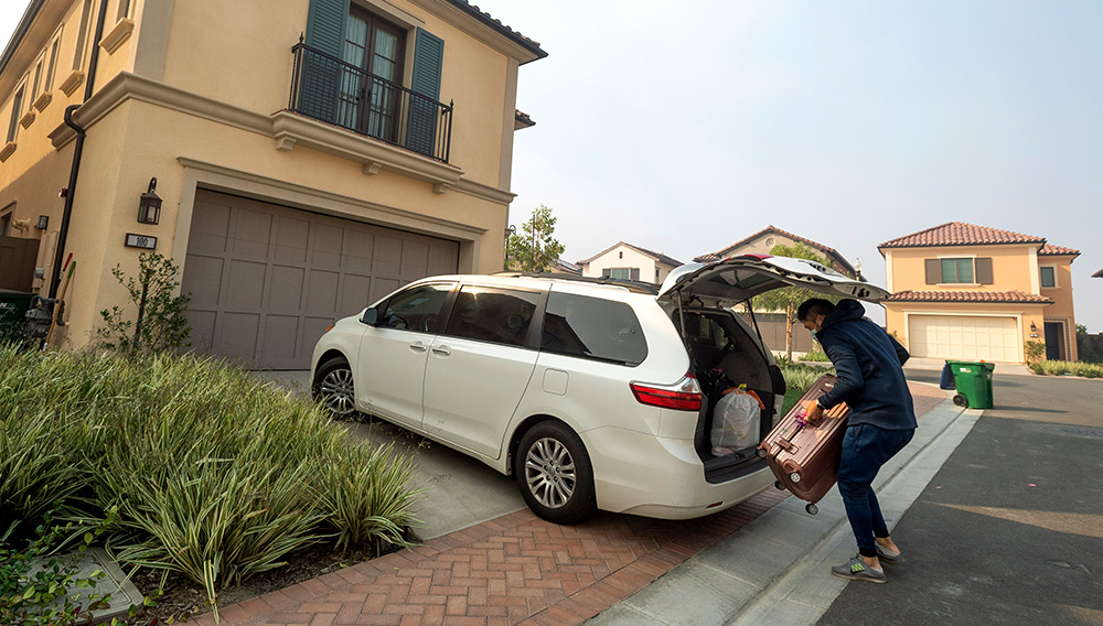 Johnny Jo packs up his family's belongings in the Orchard Hills community in Irvine, CA on Monday, October 26, 2020. The area was put under a mandatory evacuation order as the Silverado fire threatened homes. (Photo by Paul Bersebach, Orange County Register/SCNG)