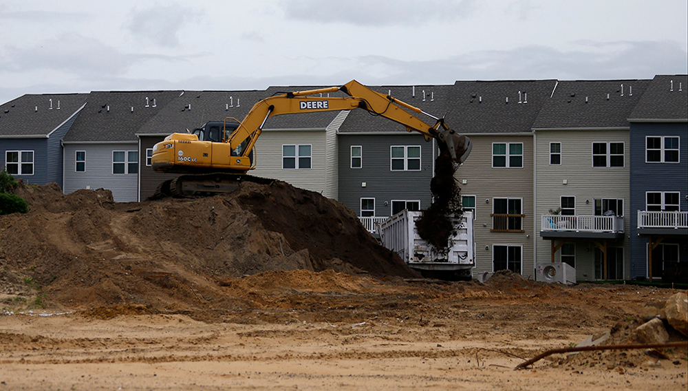 A construction crew loads dirt on a building site, Monday, May 18, 2020 in East Greenwich, N.J. | Matt Slocum, AP