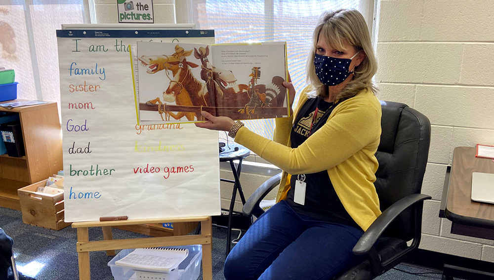 In this photo provided by Julie Mackett, the kindergarten teacher conducts her class at Ft. Meigs Elementary School, in Perrysburg, Ohio. (Courtesy of Julie Mackett via AP)