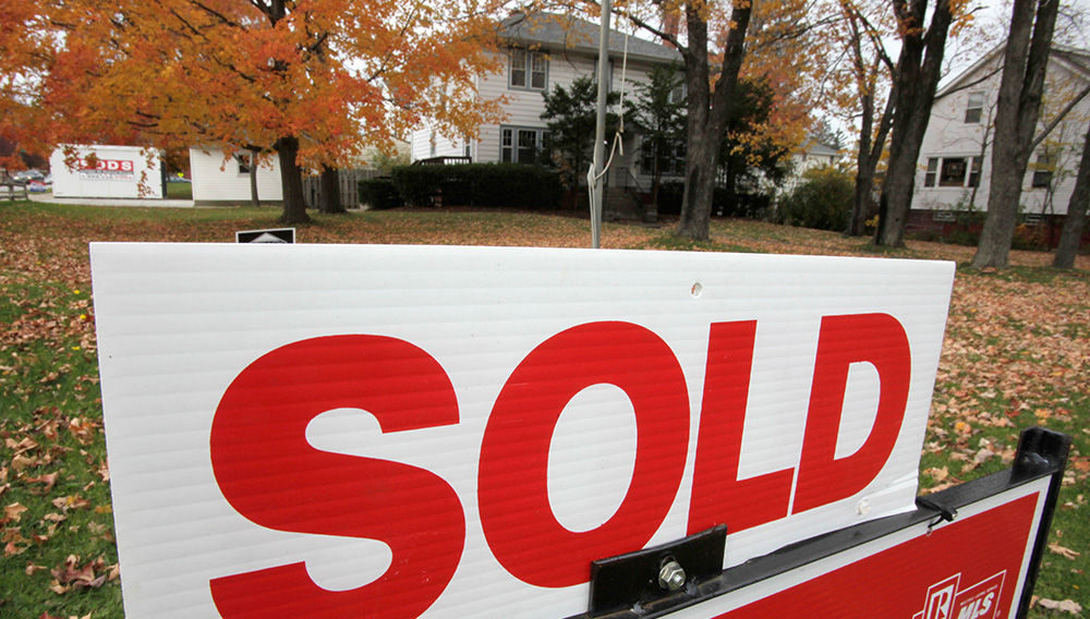 In this photo take Oct. 26, 2010, a sold sign is displayed outside a house. Texas home sellers had lived in their property a median of 12 years. (AP Photo/Amy Sancetta)