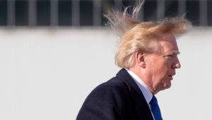 US President Donald Trump's blows in the wind as he boards Air Force One before flying to Vietnam to attend the annual Asia Pacific Economic Cooperation (APEC) summit at Beijing airport on November 10, 2017. Photo: JIM WATSON/AFP/Getty Images