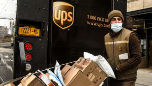 A United Parcel Service worker delivers packages in New York City. | Stephanie Keith/Getty Images