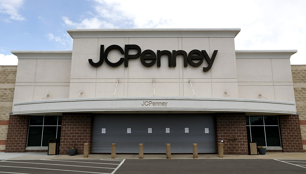 FILE - In this May 8, 2020, file photo, a parking lot at a JC Penney store is empty in Roseville, Mich. J.C. Penney is on course to emerge from bankruptcy by Thanksgiving, after a U.S. bankruptcy court approved the sale of the ailing retailer to two of the nation's largest landlords and its primary lenders. (AP Photo/Paul Sancya, File)