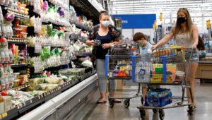 Shoppers are seen wearing masks while shopping at a Walmart store in Bradford, Pennsylvania, U.S. July 20, 2020. REUTERS/Brendan McDermid/File Photo