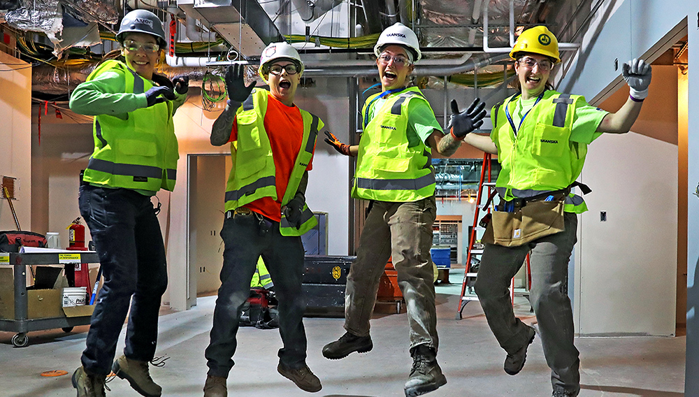 L-R Jackie Robbins, Peyton Stelzer, Sydney Dole and Alicia Miksic at the Brigham and Women's Hospital emergency department construction site. (David L Ryan/Globe Staff)