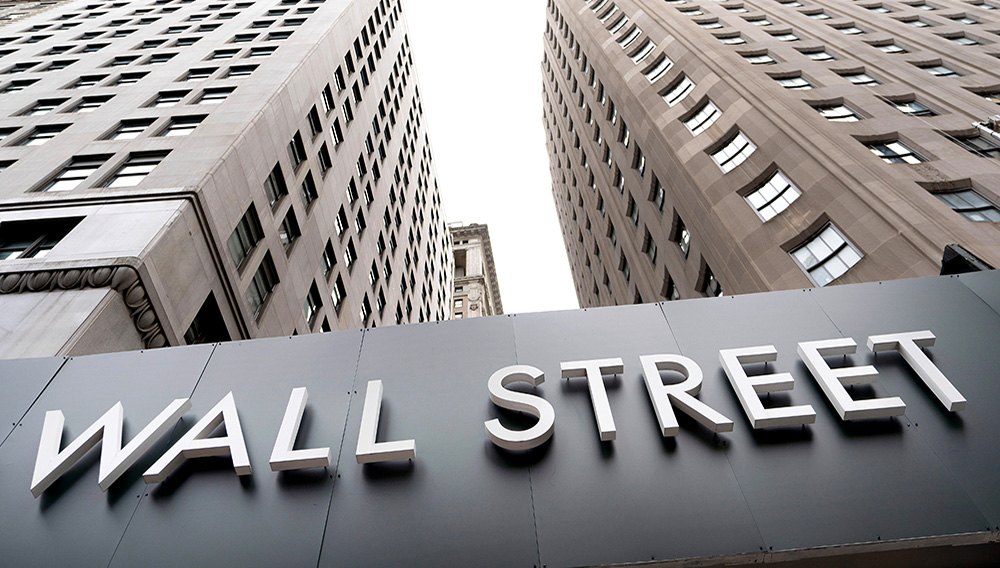 FILE - In this Aug. 31, 2020 file photo, buildings line Wall Street, in New York. (Mark Lennihan, File/Associated Press)