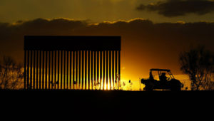 Authorities pass a border wall construction site, in Mission, Texas, Monday, Nov. 16, 2020. President-elect Joe Biden will face immediate pressure to fulfill his pledge to stop border wall construction. But he will confront a series of tough choices left behind by President Donald Trump, who's ramped up construction in his final weeks. (AP Photo/Eric Gay)