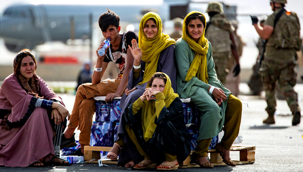 Thousands of Afghans are trying to fly out of Afghanistan after the Taliban takeover. | Source: US MARINE CORPS/REUTERS