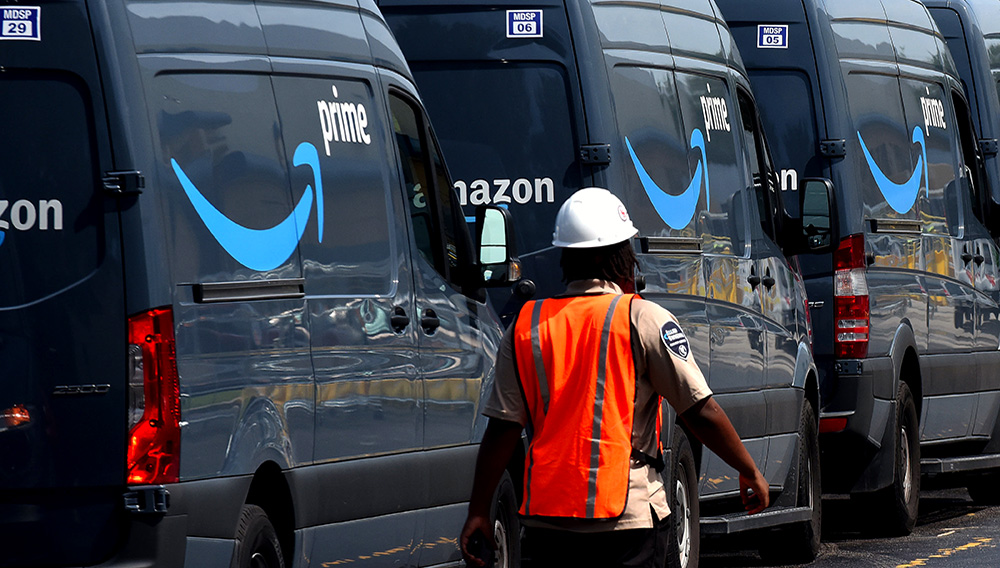 Amazon vans line up at a distribution center to pick up packages for delivery on Amazon Prime Day in Orlando, Florida. | Paul Hennessy | NurPhoto | Getty Images
