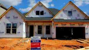 """A home under construction stands behind a """"sold"""" sign in a new development in York County, South Carolina, U.S., February 29, 2020. REUTERS/Lucas Jackson/File Photo"""