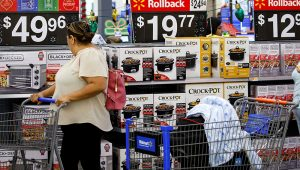 A customer browses products at a Walmart store in Burbank, California. | Patrick T. Fallon | Bloomberg | Getty Images