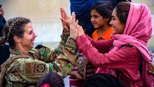 Kabul: In this image provided by the U.S. Marines, a U.S. Airman with the Joint Task Force-Crisis Response high fives a child after helping reunite their family at Hamid Karzai International Airport in Kabul, Afghanistan, Friday, Aug. 20, 2021. AP/PTI Photo