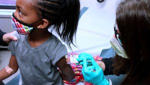 Amirah, 7, receives an injection of the Pfizer COVID-19 vaccine at Cincinnati Children's Hospital. (Courtesy Cincinnati Children's Hospital)